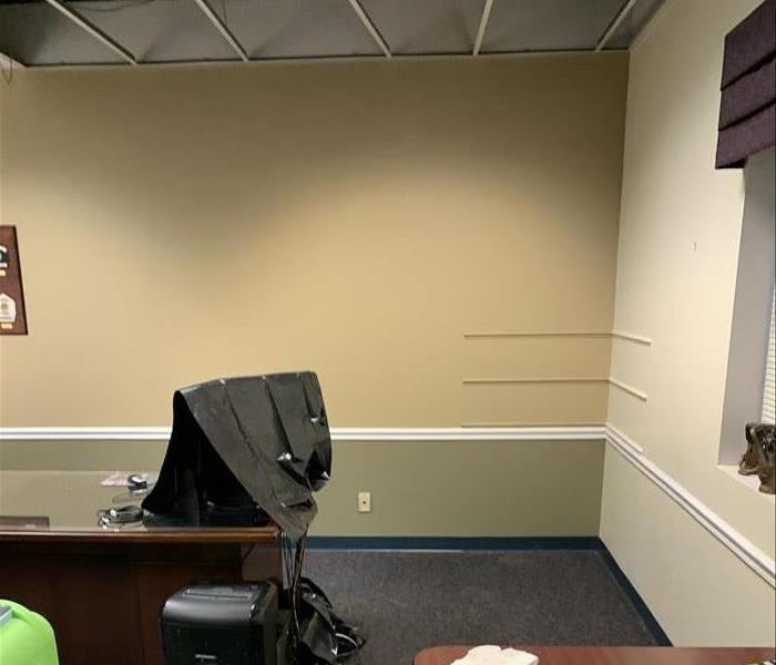 Office with wet carpet and ceiling tiles missing