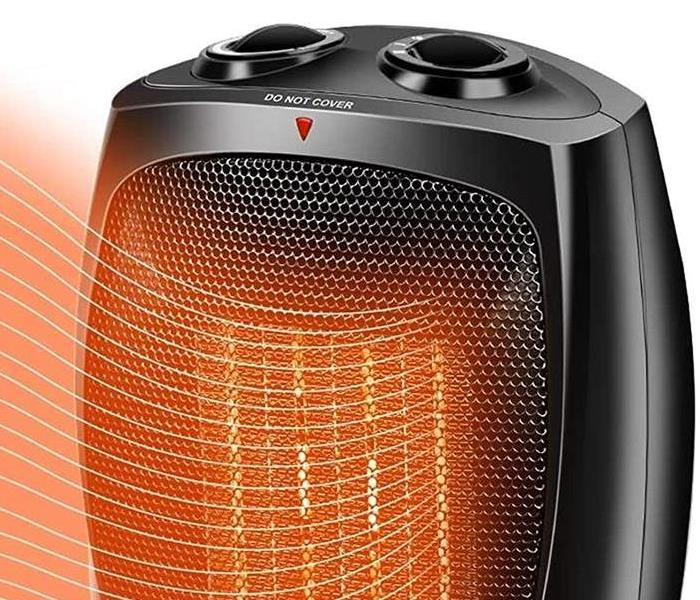 Black space heater with orange heat waves coming out